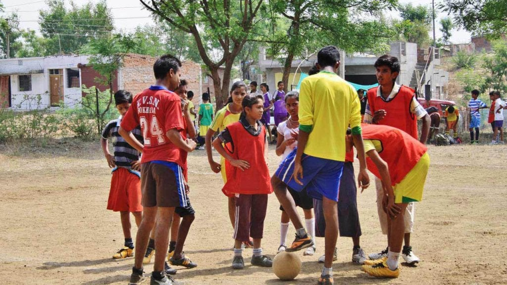 Young people playing football in India