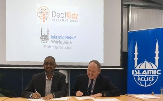 Naser Haghamed, Chief Executive Officer, Islamic Relief Worldwide and Steve Crump, Chief Executive Officer, DeafKidz International, sign the Memorandum of Understanding