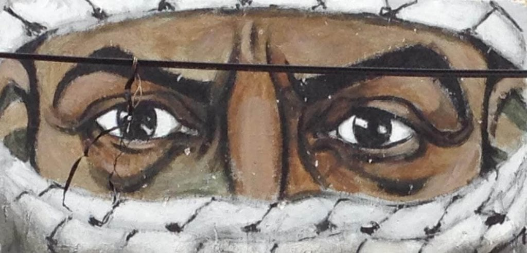 Wall art of angry eyes